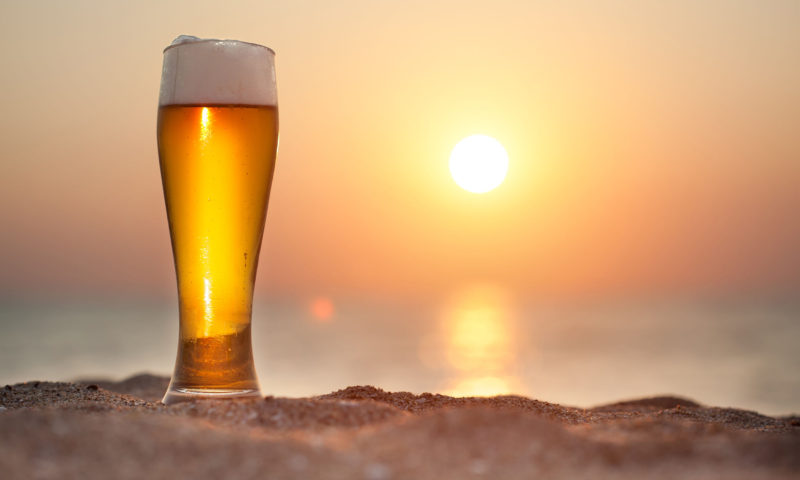 31266585 - glass of beer on a sunset